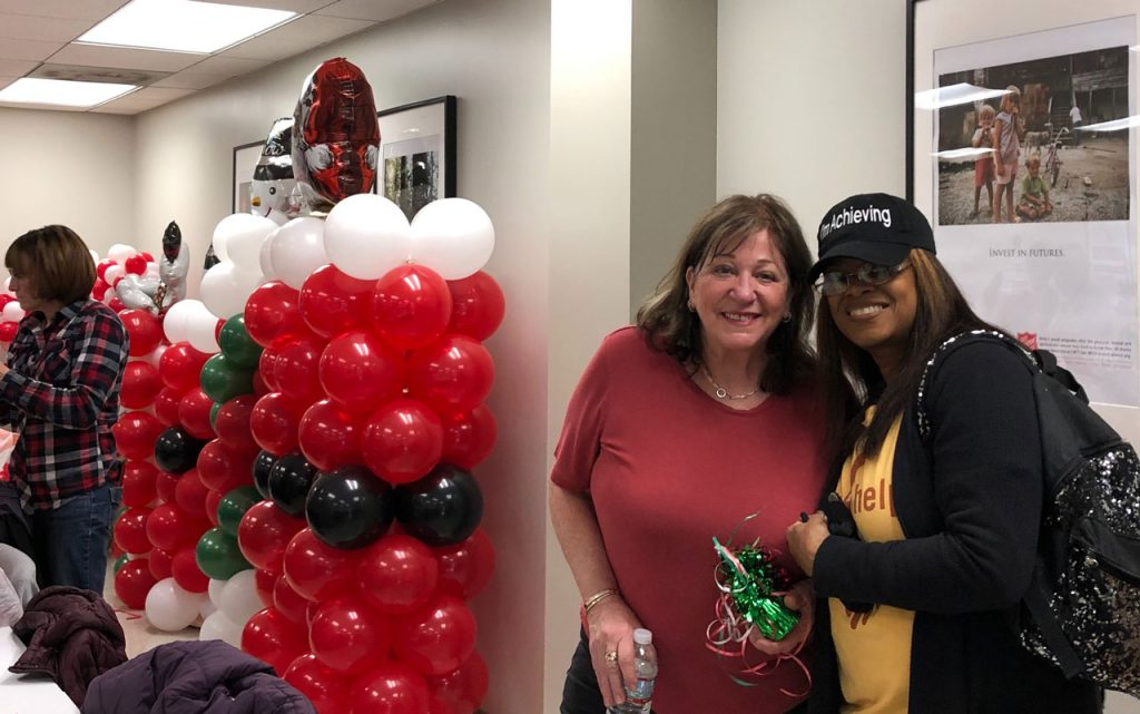 Volunteers ring in the holidays at Salvation Army Harbor Light 37