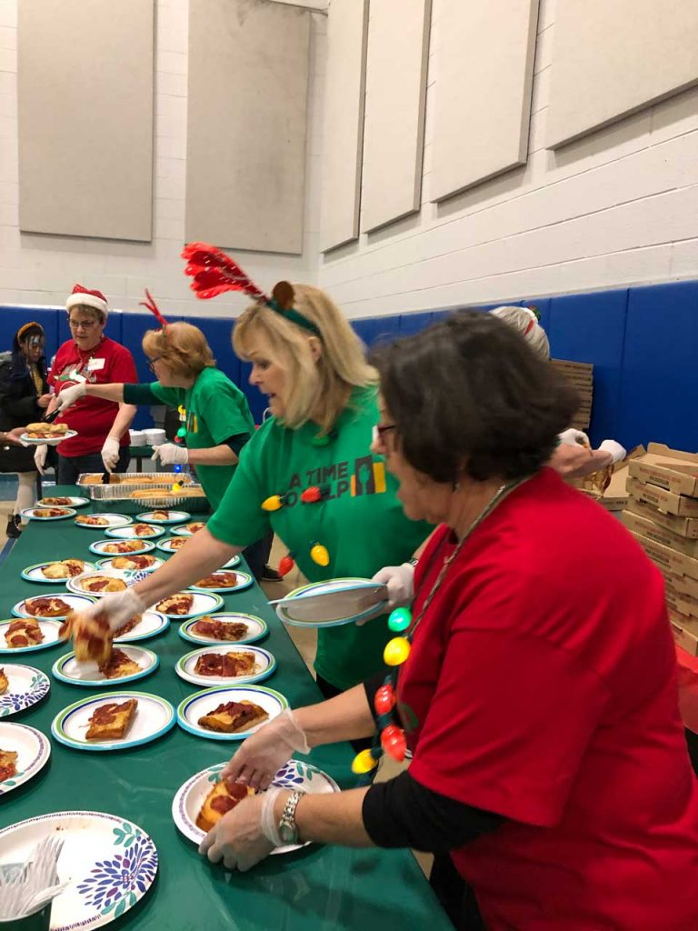 Volunteers ring in the holidays at Salvation Army Harbor Light 10