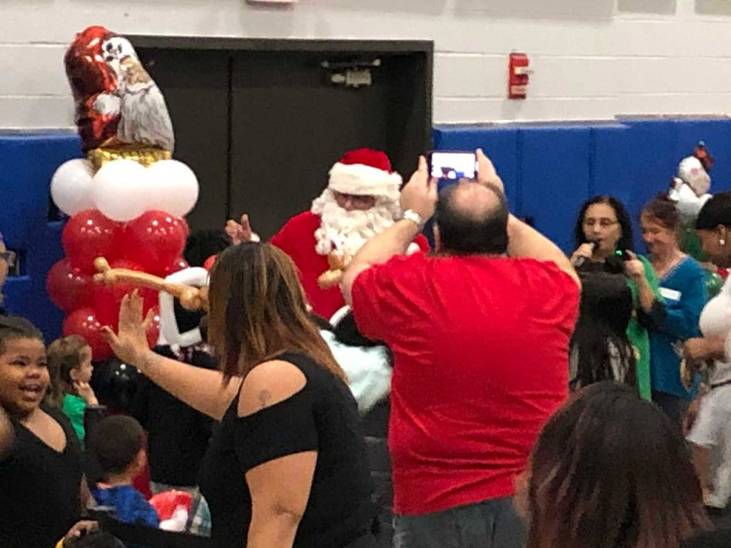 Volunteers ring in the holidays at Salvation Army Harbor Light 7